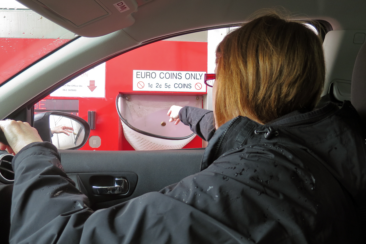 Kris paying the toll of 1.95 euros (about $2.70).