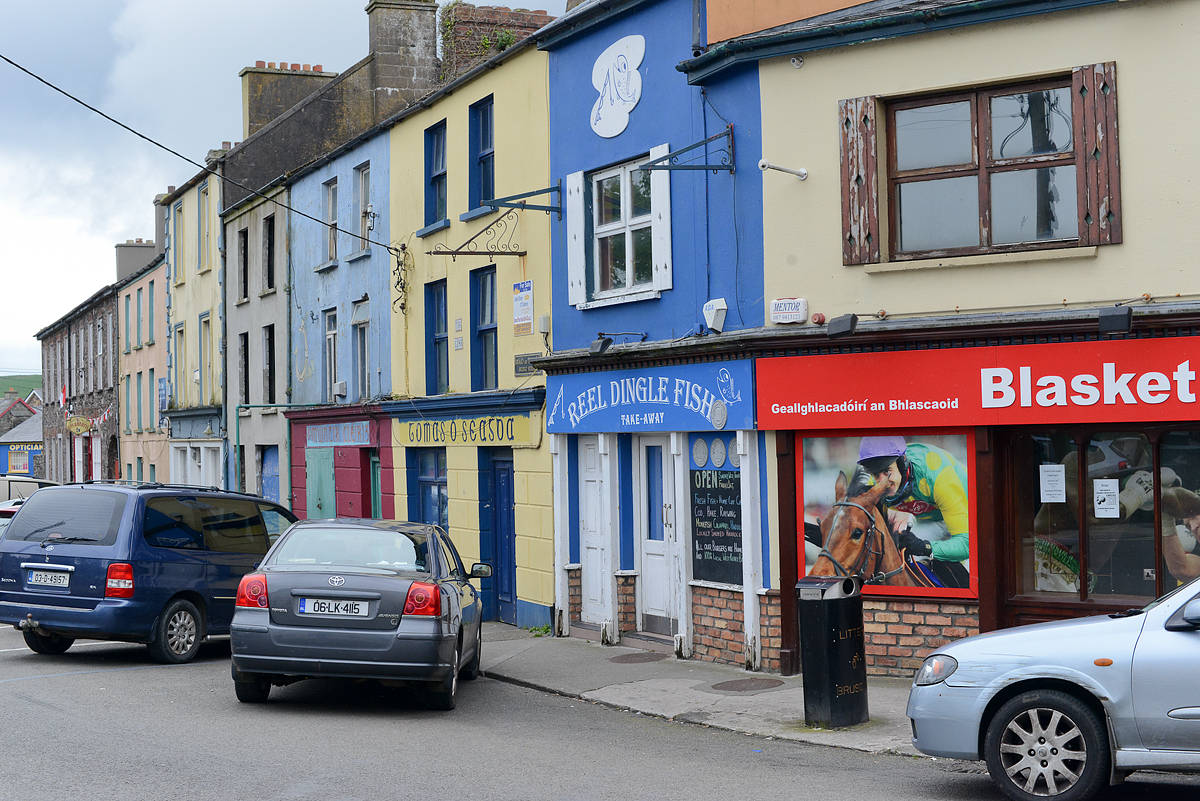The town of Dingle (Irish: An Daingean), population 1900. Dingle is situated in a Gaeltacht (Irish-speaking) region. The town was developed as a port following the Norman invasion of Ireland.