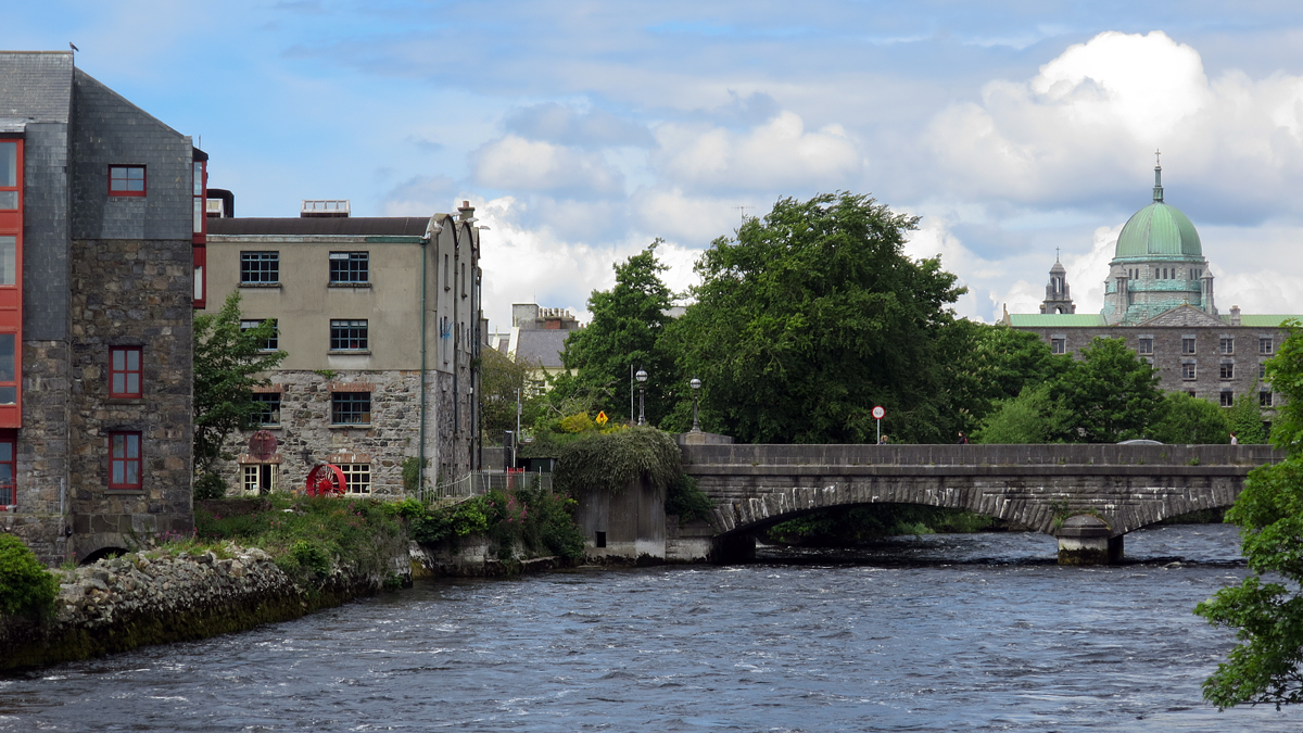 A view taken along Quay Street in Galway (Irish: Gaillimh), with the River Corrib flowing beneath us and Galway Cathedral in the distance. The city dates to the 12th century.