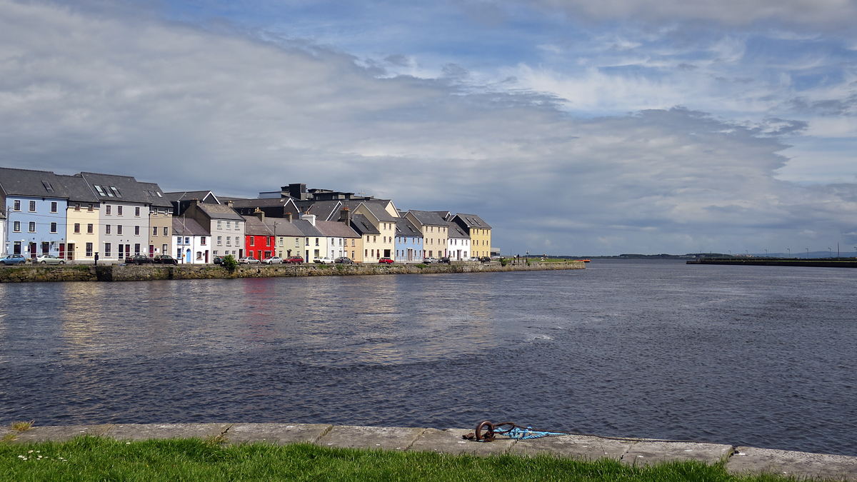 The colorful houses of Ballyknow Quay where the River Corrib enters Galway Bay…