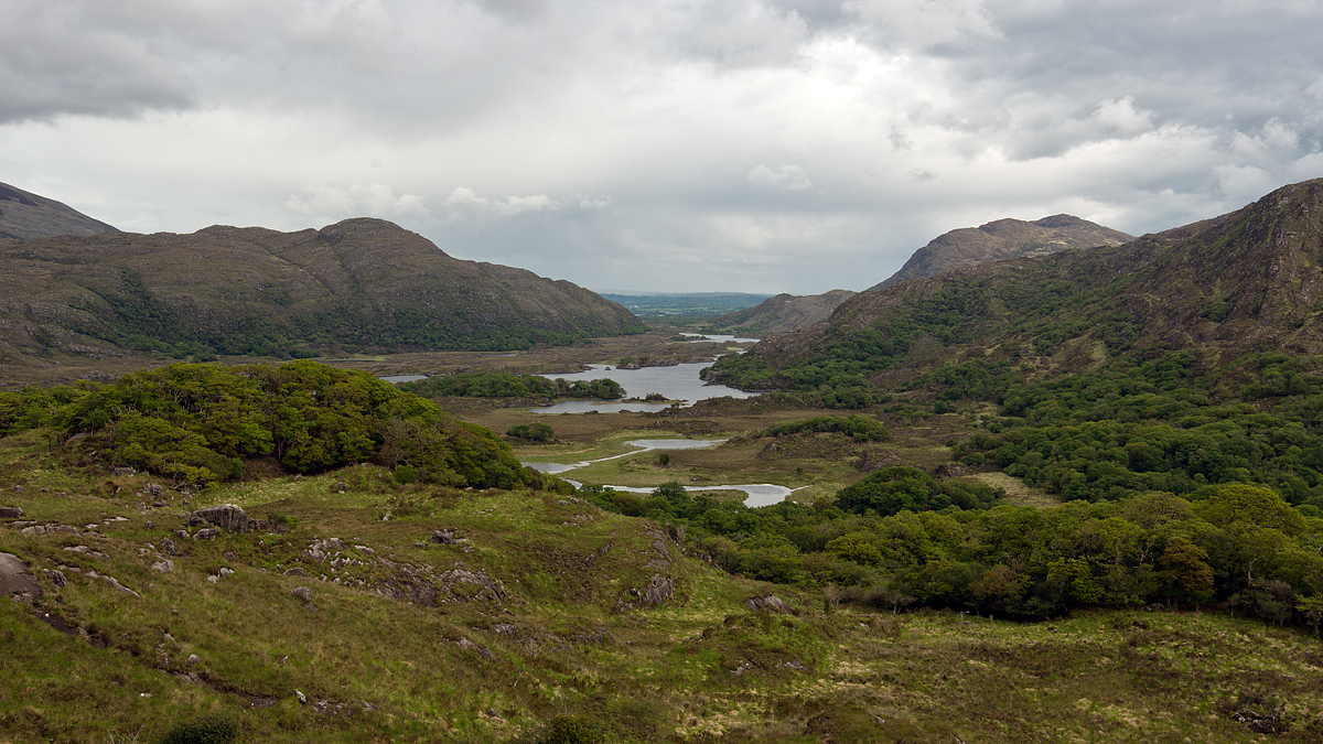 The Lakes of Killarney seen from Ladies View. The name apparently stems from the admiration of the view given by Queen Victoria's ladies-in-waiting during their 1861 visit. The Gap of Dunloe is in the distance.