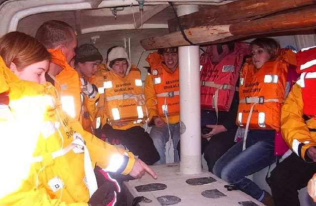 Inside the lifeboat, conditions are cramped, stuffy and uncomfortable. We'll encounter few ships in Antarctica, and in an emergency it could take many hours or even days before help arrives. (Image courtesy Oundle School.)
