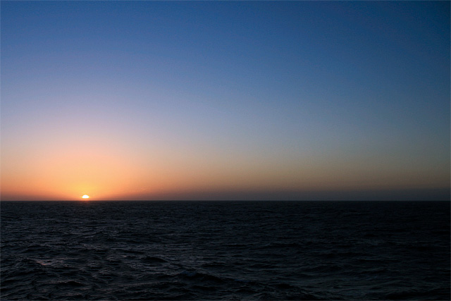 The clear skies of our first night on the open sea. The winds drop, and the sun falls into the west. Good night.