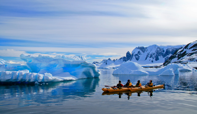 Kayak Antarctica! The water is ice cold but the sun is warm and our spirits are high.