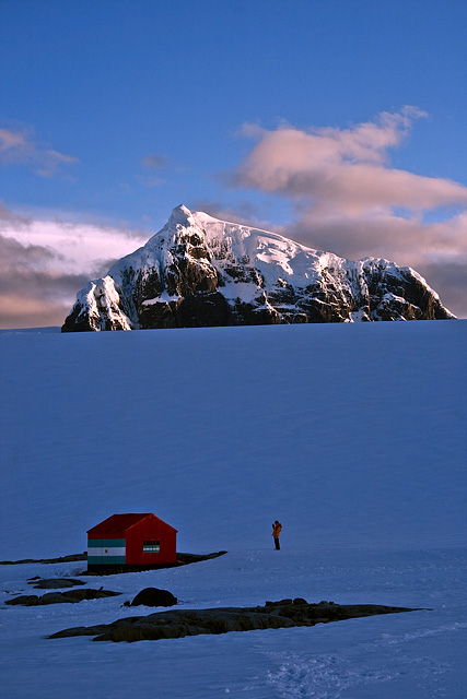 Savioa Peak dominates the local geography. The peak rises in the distance.