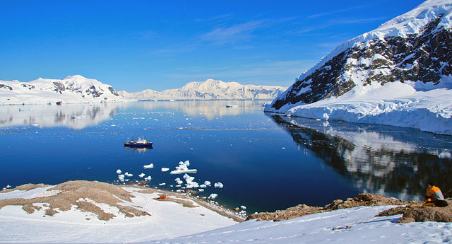 Reaching the lookout, the view of Neko Harbor is stunning. The deep rumble of calving glaciers is all around us.